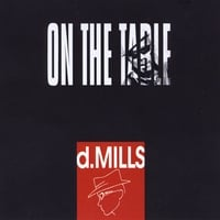 D. Mills | On the Table