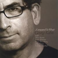 George Kahn | ...Compared To What?